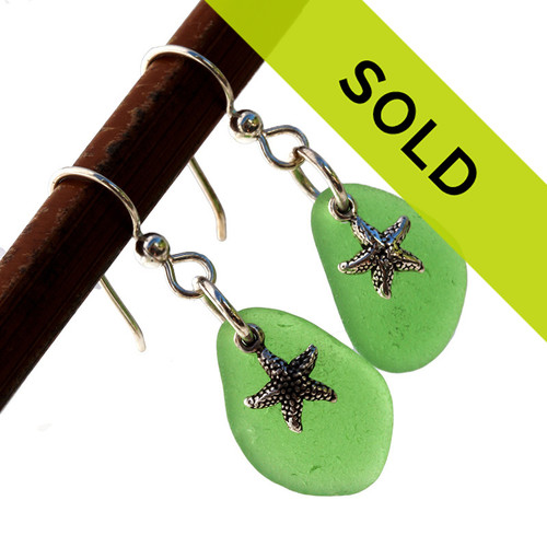 Top quality green sea glass pieces combined with solid sterling starfish charms and presented on sterling silver professional grade ear wires.