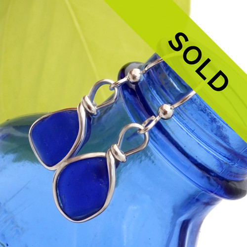 Smaller natural blue sea glass pieces set in our Original Wire Bezel© earring setting in sterling silver. These is a great setting that lets light shine through the sea glass and does not alter it from the way it was found on the beach.  Sorry this pair has SOLD!