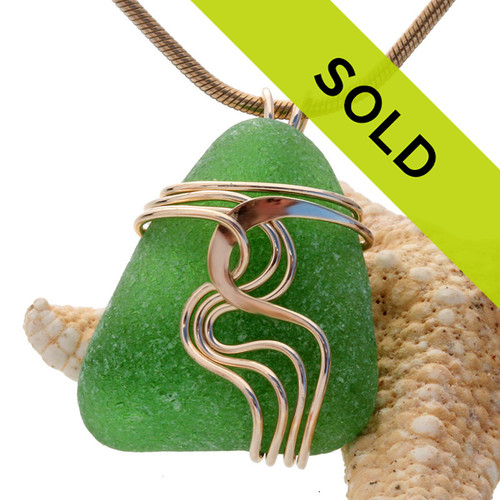 A good quality piece of vivid green sea glass set in our signature WAVES pendant setting. This setting leaves the sea glass totally open so you can reach up and feel the amazing tactile texture of this genuine sea glass piece. Rolled Gold or 14K Goldfilled is a great option that will wear just like gold at a fraction of the cost.