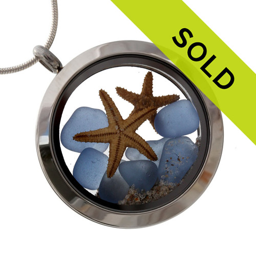 Tiny pieces of rare Carolina Blue sea glass combined with 2 starfish in a stainless steel silver locket. Sorry this locket has been SOLD!