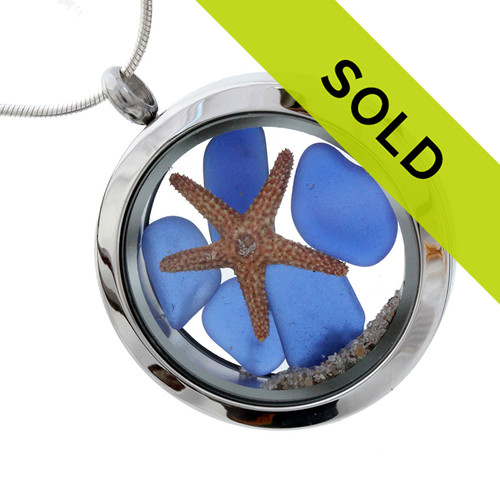Tiny pieces of rare  Blue sea glass combined with a real starfish in a stainless steel silver locket. Sorry this piece has SOLD!