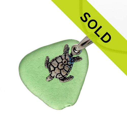"""Bright green sea glass set on a solid sterling cast bail with a sterling silver sea turtle charm. The sea glass necklace comes on our 18"""" solid sterling smooth snake chain (SHOWN and included)"""