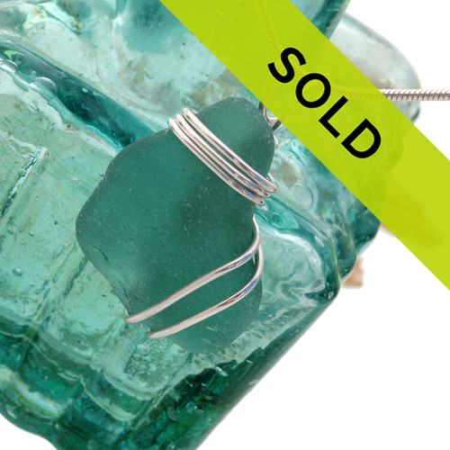 Vivid aqua sea glass from Spain set in a sterling triple necklace pendant setting.