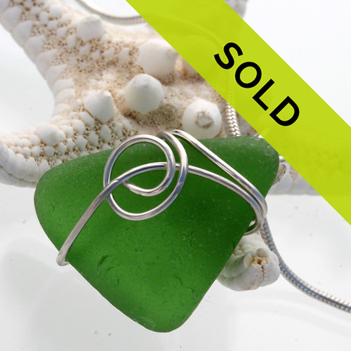 A sea inspired sterling setting and vivid green sea glass. A nice smaller pendant for any necklace!!