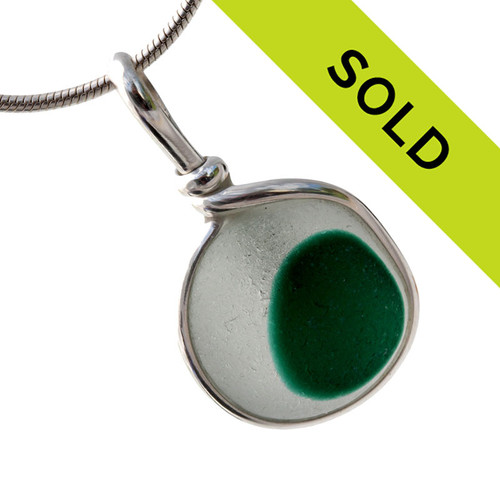Pure white sea glass with a spot of unusual green is set in our Original Wire Bezel© pendant setting. A nice medium piece for any necklace.