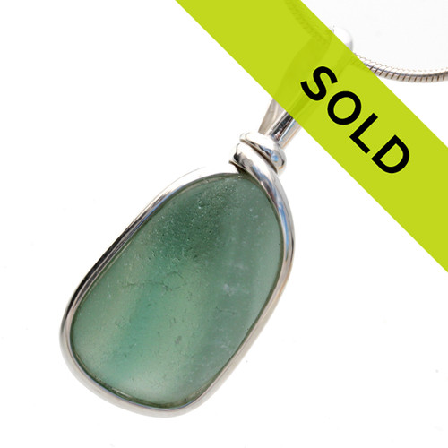 A very unusual piece of subtle mixed seafoam green sea glass from England set in our Original Wire Bezel© setting. Sorry this pendant has been SOLD!
