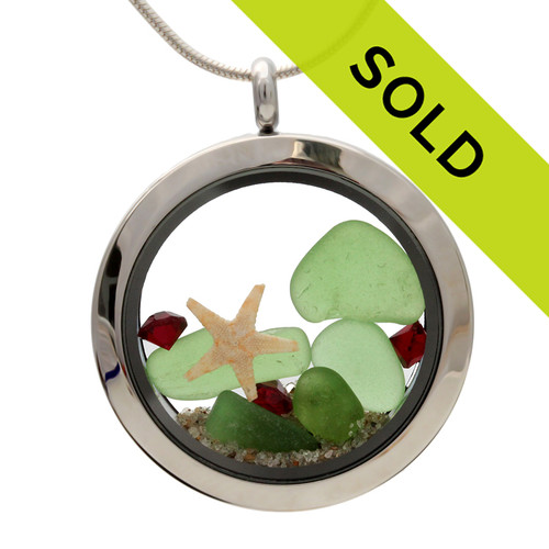 Green sea glass and vivid ruby gemstones make this a great locket necklace for the holidays. Sorry this locket has been SOLD!