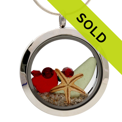 Olive green and ruby red sea glass is combined with real starfish for a holiday inspired sea glass locket. Great stocking stuffers for Christmas!  SORRY THIS CHRISTMAS SEA GLASS LOCKET HAS SOLD!