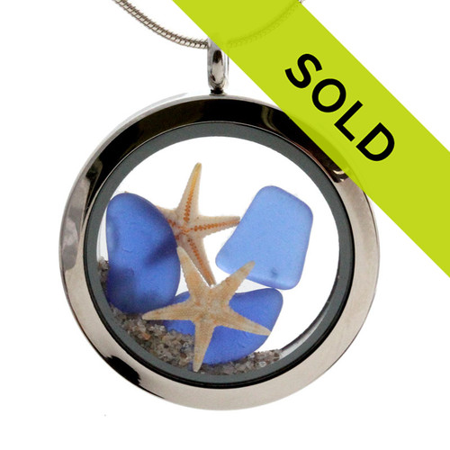Small pieces of natural beach found blue sea glass combined with a real starfish and beach sand for your own personal beach on the go!  SORRY SOLD!