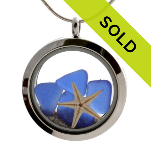 Small pieces of natural beach found blue sea glass combined with a real starfish and beach sand for your own personal beach on the go!  SORRY THIS LOCKET HAS SOLD!