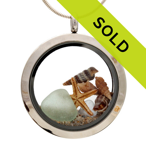 Small pieces of natural beach found pastel sea glass combined with a real starfish, shells  and beach sand for your own personal beach on the go!  This locket has been SOLD!