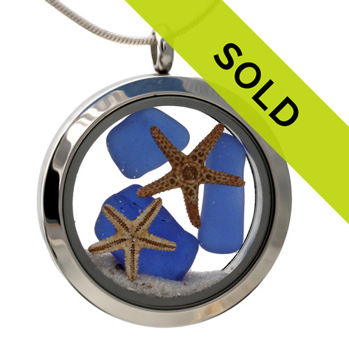 Small pieces of natural beach found blue sea glass combined with a real starfish and beach sand for your own personal beach on the go!