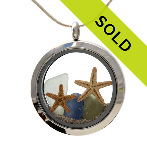 Small pieces of genuine sea glass in blue, seafoam green and peridot green are combined with real beach sand and two tiny starfish for your own personal beach on the go!