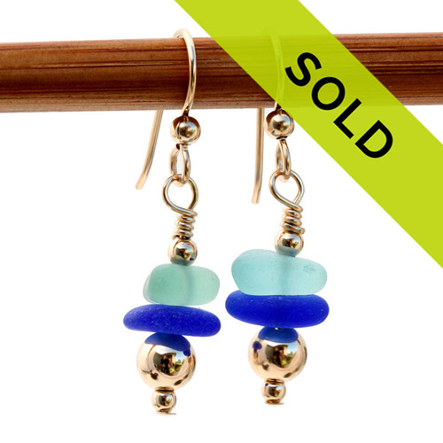 Vivid aqua and rich cobalt blue sea glass pieces combined with 14K Goldfilled beads in an elegant earring pair.