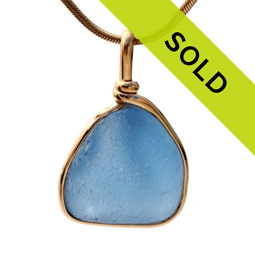 A thick well frosted piece of Carolina or Light Blue sea glass set in our Original Wire Bezel setting. Sorry this sea glass jewelry selection has been sold!