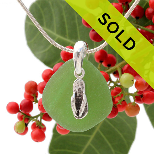 Beach found green sea glass is combined with a solid sterling flip flop charm and presented on an 18 Inch solid sterling snake chain. SOLD SORRY!
