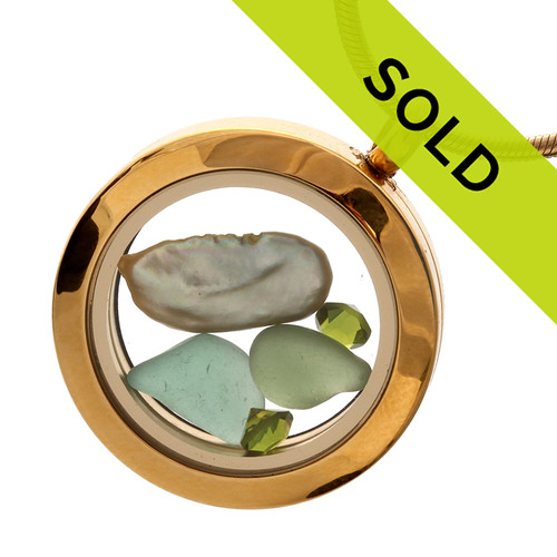 Green elegant sea glass with a green freshwater stick pearl and perdiot green gemstones in this goldtone stainless steel locket necklace. Sorry this locket has been sold!