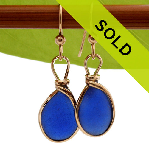Two perfect cobalt blue sea glass pieces set in our Original Wire Bezel© earring setting in 14K goldfilled earrings