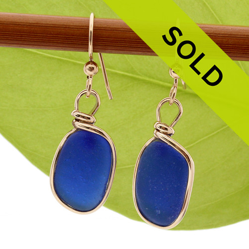Perfect cobalt blue sea glass pieces set in our Original Wire Bezel© earring setting in 14K goldfilled earrings.  These sea glass pieces are UNALTERED from the way they were found on the beach. TOP QUALITY GENUINE SEA GLASS!