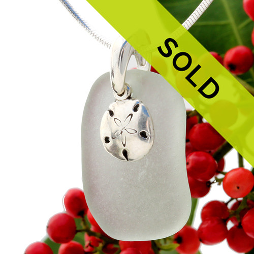 Beach found white sea glass is combined with a solid sterling silver sandollar charm and presented on an 18 Inch solid sterling snake chain.