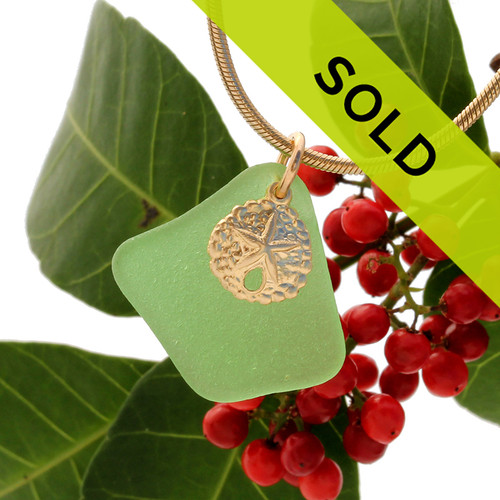 Classic green sea glass combined with a 14K goldfilled sandollar charm for a simple elegant necklace.