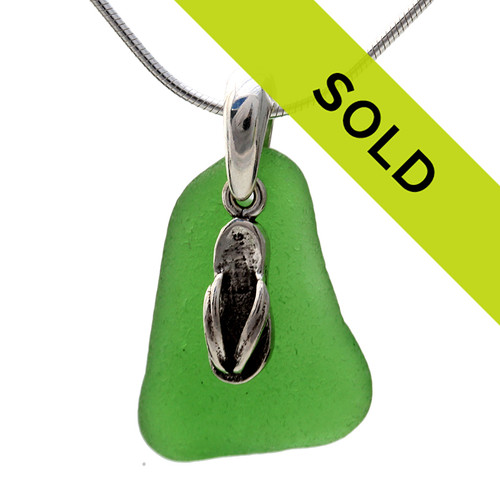 Beach found vivid green sea glass is combined with a solid sterling flip flop charm and presented on an 18 Inch solid sterling snake chain. A simple elegant sea glass necklace for any time of year!
