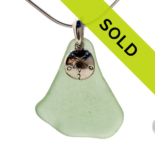 Beach found seafoam green sea glass necklace is combined with a solid sterling sandollar charm and presented on an 18 Inch solid sterling snake chain.