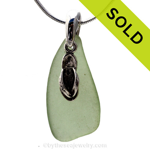 Beach found seafoam green sea glass is combined with a solid sterling flop charm and presented on an 18 Inch solid sterling snake chain. Sorry this sea glass jewelry selection has been sold!