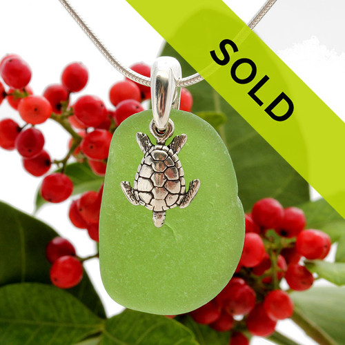 Beach found vivid green sea glass is combined with a solid sterling sea turtle charm and presented on an 18 Inch solid sterling snake chain.