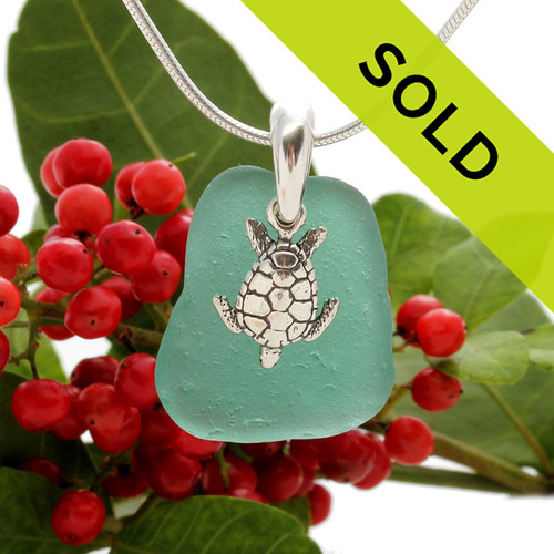 Beach found vivid aqua green sea glass is combined with a solid sterling sea turtle charm and presented on an 18 Inch solid sterling snake chain.