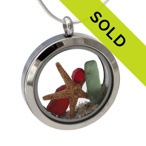 Green and rare red sea glass and a real starfish and beach make this a great locket necklace for the holidays.