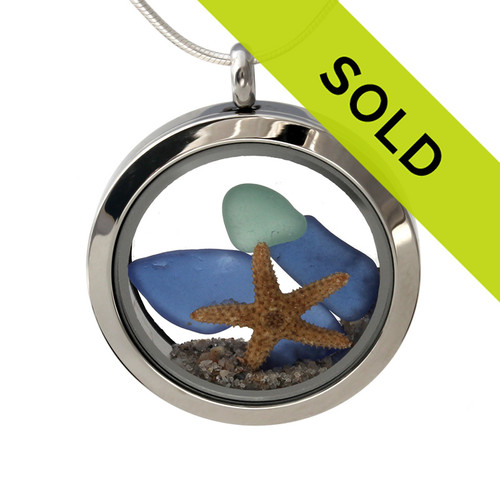 Small pieces of natural beach found blue and aqua blue sea glass combined with a real starfish and beach sand for your own personal beach on the go!