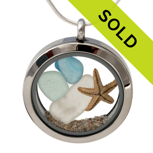 Small pieces of natural beach found sea glass combined with a real starfish and beach sand for your own personal beach on the go!