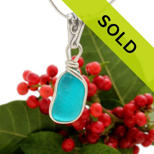A beautiful piece of VIVID electric mixed aqua ea glass set for a necklace in our Original Sea Glass Bezel© setting. this piece comes on a deco bail.