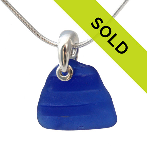 This textured blue ridged sea glass necklace in sterling has been SOLD!