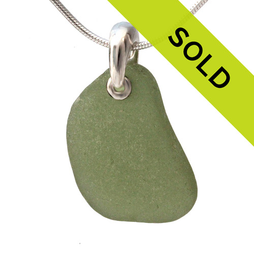 This An unusual piece of green sea glass set on a silver necklace has been sold!