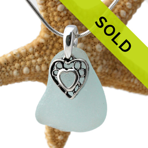 A perfect piece of natural pale aqua blue sea glass set on a solid sterling hand cast bail with a sterling silver heart i hearts charm. A perfect sea glass necklace for any sea glass lover!