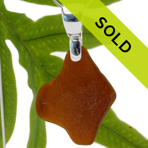 A HUGE amber brown sea glass set on a solid sterling hand cast bail. A perfect sea glass necklace for any sea glass lover!