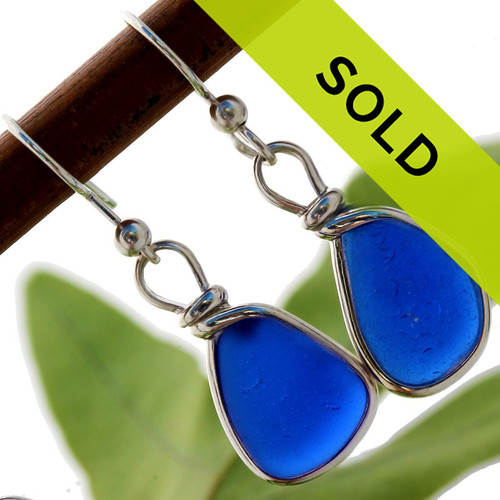 A beautiful pair of natural blue beach found sea glass pieces set in our Original Wire Bezel© setting that leaves the sea glass TOTALLY UNALTERED from the way it was found.