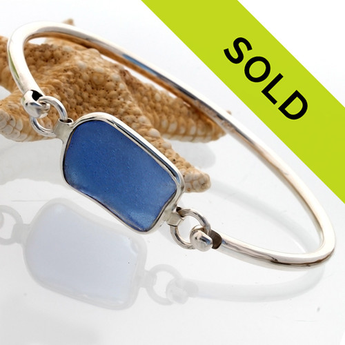 This beautiful blue sea glass bracelet on a sterling bangle has sold!