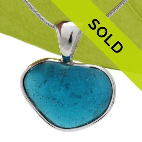 This STUNNING Vivid and Bubbled piece of sea glass piece is from England. It is set in a solid sterling wire with a cast silver bail. Great and will accommodate ANY necklace you may already own.  This sea glass heart shaped piece is TOTALLY natural and a rare and coveted find.