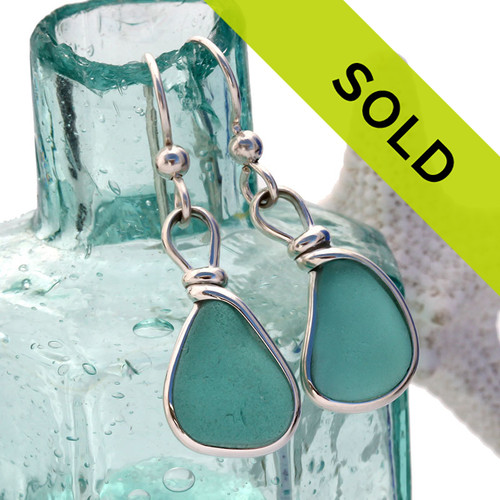 Vivid tropical aqua sea glass from Hawaii is set in our Original Wire Bezel© setting for a stunning pair of earrings. Sorry this pair of sea glass earring has been sold!