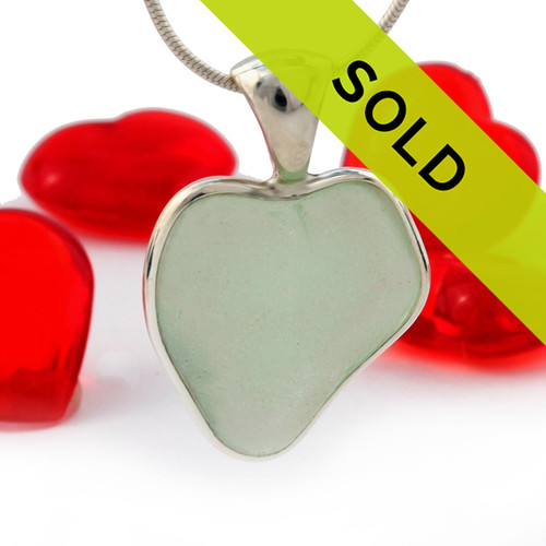 A natural seafoam green sea glass heart set in our Deluxe Wire Bezel© A great necklace for any time of year and perfect for any sea glass lover!