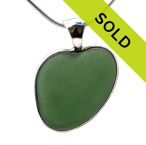 Genuine sea glass hearts are a RARE phenomena and cherished among sea glass lovers! This piece is set in solid sterling silver in our Deluxe Wire Bezel setting. Sorry this sea glass jewelry piece has been sold!