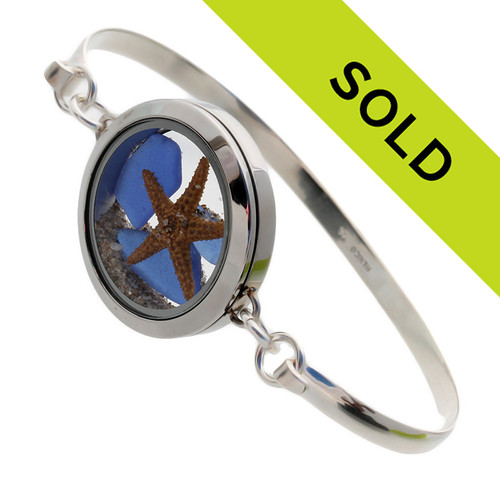 Genuine Sea Glass Locket Bracelet Tiny blue genuine  sea glass combined with a small starfish in this one of a kind sea glass bangle bracelet!   Sand from the beaches of  Florida complete your Beach To Go!