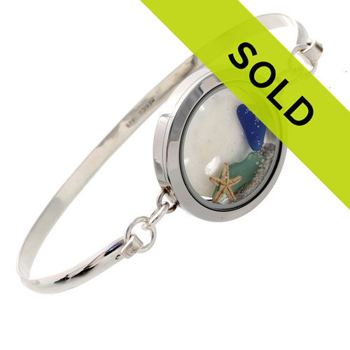 Genuine Sea Glass Locket Bracelet Tiny blue and aqua genuine sea glass combined with a small starfish and large sandollar in this one of a kind sea glass bangle bracelet!   Sand from the beaches of  Florida complete your Beach To Go!