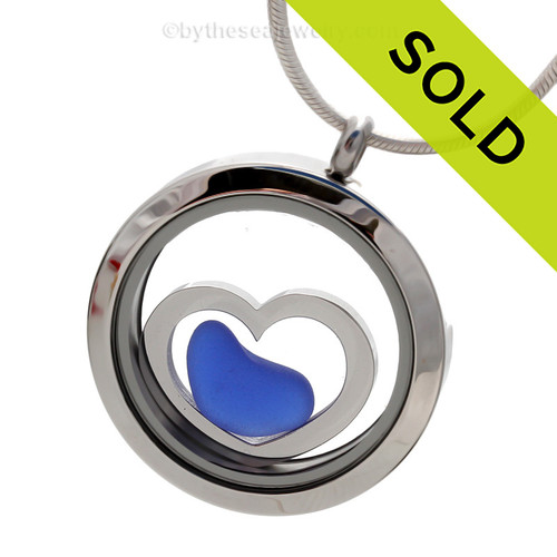 A natural blue sea glass heart combined a large silver heart in this sea glass locket necklace.  Sorry this Sea Glass Jewelry selection has been SOLD!