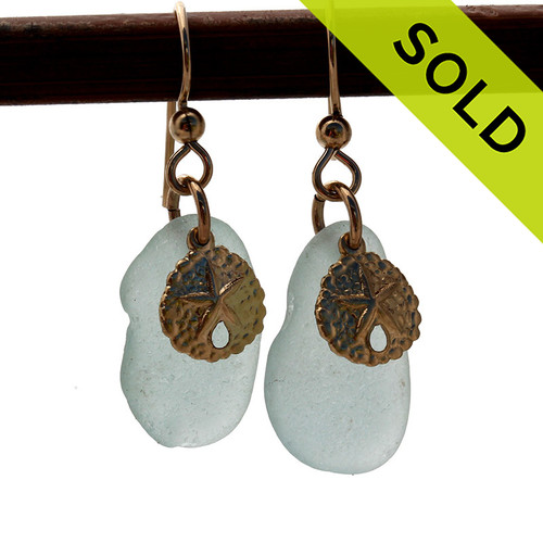 Pale aqua sea glass pieces combined with goldfilled (not plated) sandollar charms make for a lovely pair of sea glass earrings. SOLD - Sorry these Sea Glass Earrings are no longer available.