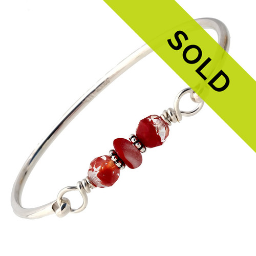 A nice piece of mixed rare red sea glass combined with vintage mixed ruby beads and a large bangle bracelet. The sea glass is beach found and tumbled only by tide and time found on the beaches of Seaham England. Sorry this piece has sold!