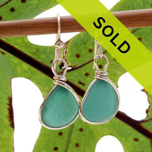 A lovely deep aqua green sea glass pair set in our Original Wire Bezel setting in gold. These are natural unaltered sea glass pieces left just the way they were found on the beach. Guaranteed to get you compliments!